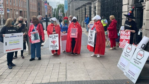 Protesters gathered outside Leinster House today
