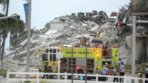 Rescue teams search in the rubble of the partially collapsed 12-storey condominium building in Surfside, Florida