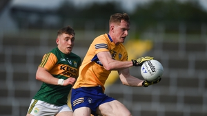 Pearse Lillis of Clare in action against Dara Moynihan of Kerry
