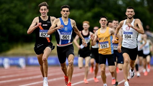 Andrew Coscoran, second from left, wins the men's 1500m