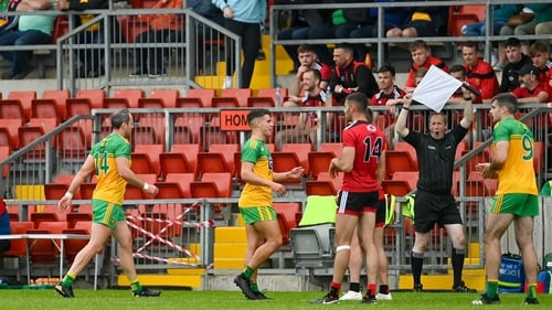 Michael Murphy leaves the field of play in the first half at Páirc Esler Park