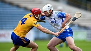 Shane Bennett of Waterford in action against Paul Flanagan of Clare