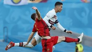 Portugal's forward Cristiano Ronaldo (R) vies with Thomas Vermaelen for possession
