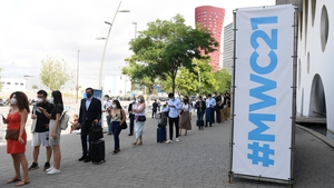 Visitors queue to take a Covid-19 test before entering the Mobile World Congress (MWC) fair in Barcelona today