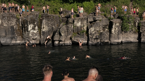 Residents are urged to keep cool during record heatwave