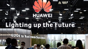 People visit the Huawei stand at the Mobile World Congress fair in Barcelona today