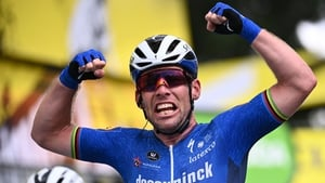 Cavendish celebrates as he crosses the finish line of the fourth stage