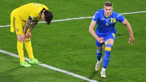 Artem Dovbyk (R) celebrates after scoring Ukraine's extra time winner