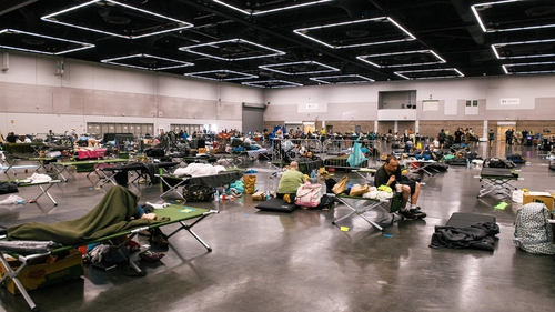 People resting at a 'cooling station' in Oregon, US, during the heatwave in June