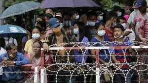 People wait for their relatives to be released from the Insein prison compound in Yangon