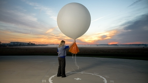 Meteorologist Carrie Suffern releases a weather balloon. Photo: Benjamin C. Tankersley for The Washington Post via Getty Images