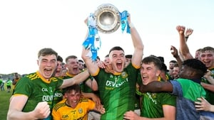 Meath captain Eoghan Frayne lifts the cup as his team-mates celebrate