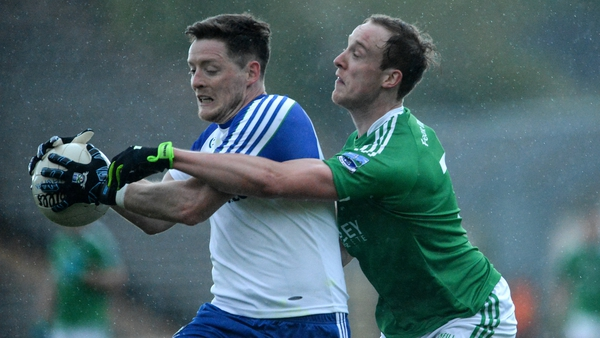 Monaghan's Conor McManus attempts to escape the clutches of Che Cullen of Fermanagh