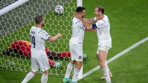 Italian defenders celebrate after preventing a Romelu Lukaku chance