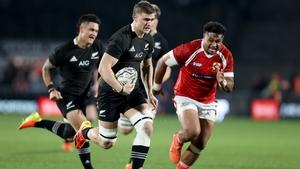 Dalton Papalii of the All Blacks makes a break against Tonga