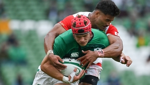Siosaia Fifita attempts to tackle the outstanding Josh van der Flier