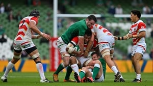 Amanaki Mafi of Japan is tackled by James Ryan and Billy Burns