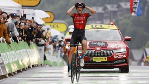 Dylan Teuns crosses the finish line in Le Grand-Bornand