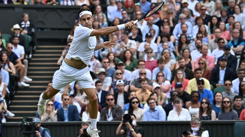 Roger Federer fires a forehand in his win over Cameron Norrie
