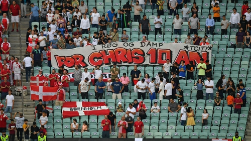 Denmark fans display a tribute banner to Christian Eriksen
