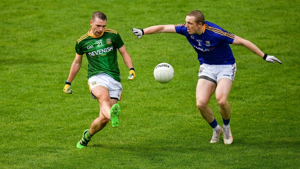 Joey Wallace of Meath in action against Patrick Fox of Longford