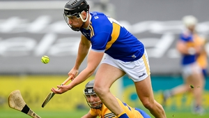 Tipperary forward Dan McCormack beats Cathal Malone to possession