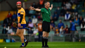 Referee James Owens indicates a penalty for Tipperary during the Munster semi-final against Clare
