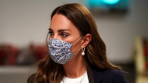 Kate Middleton is not experiencing any symptoms (file image)