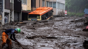 Mud and debris piled high following days of heavy rain in Atami, Japan
