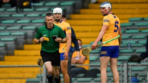 Diarmuid Ryan appeals to James Owens after he had issued a yellow card to his team mate Aidan McCarthy