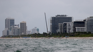 Cranes mark the skyline where the apartment block stood in Surfside, Florida