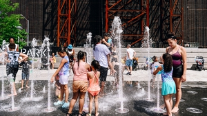 Children cool off in a park in Brooklyn, New York