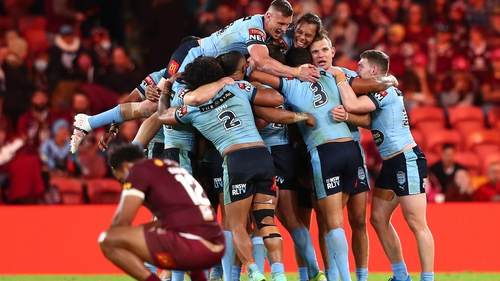 The New South Wales Blues celebrate winning Game 2 to secure this season's series