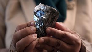 A member of the Botswana cabinet holds a 1,174-carat diamond in Gaborone, Botswana