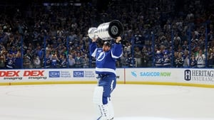 Curtis McElhinney of the Tampa Bay Lightning hoists the Stanley Cup