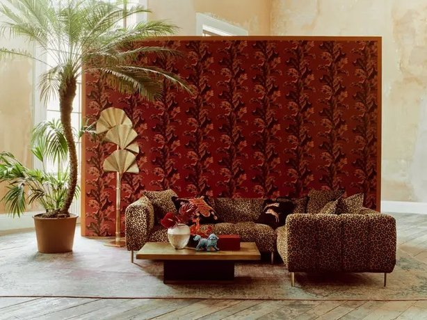 Paloma Home Oriental Leaves Wallpaper, £35 per roll; Paloma Home Rock N'Roll Leopard Print Sofa, from £4,399, Sofology (Michael Sinclair/Olivia Gregory/PA)