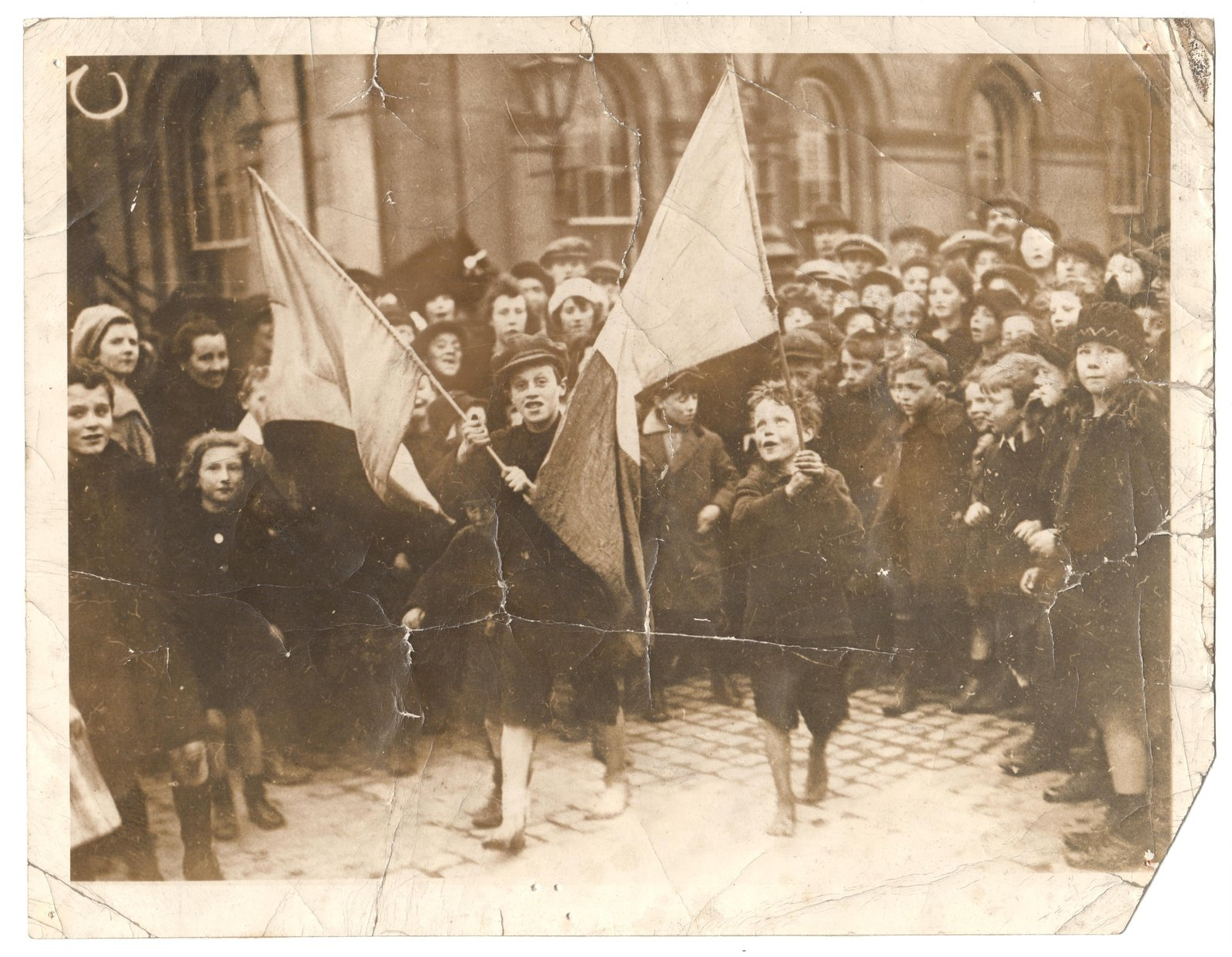 Image - Joy on the streets of Dublin after the Truce was declared: children wave Tricolours. (Credit: Courtesy of Kilmainham Gaol Museum.19PO-1A33-24)