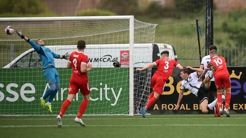 David McMillan heads home Dundalk's second goal