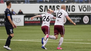 Bohs goalscorer Ross Tierney is congratulated by his team-mate Georgie Kelly in Reykjavik