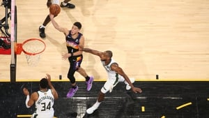 Devin Booker #1 of the Phoenix Suns drives to the basket