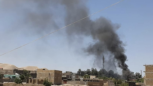 Smoke rises from houses amid ongoing fighting between Afghan security forces and Taliban fighters in Qala-i-Naw