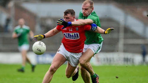 Brian Hurley of Cork in action against Sean O'Dea of Limerick during the 2019 Munster semi-final