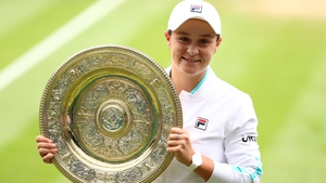 The Australian celebrates with the Venus Rosewater Dish trophy