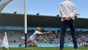 Laois goalkeeper Enda Rowland saves a penalty from Antrim's Neil McManus