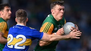 David Clifford of Kerry is tackled by Tipp's Jason Lonergan.