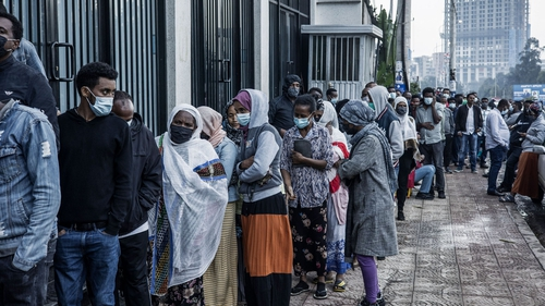 A long queue of voters wait outside a polling station in Addis Ababa, Ethiopia