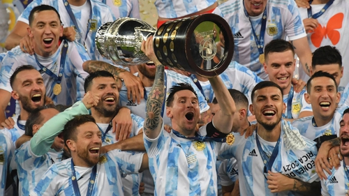 Lionel Messi lifts the Copa America trophy as he celebrates with his Argentina teammates