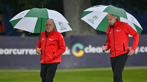 Umpires Alan Neill, left, and Roland Black