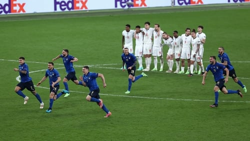 The Italian team react after Gianluigi Donnarumma's save seals the Euro 2020 title for them against England last night.