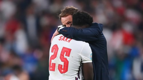Bukayo Saka is consoled by England manager Gareth Southgate after missing the final penalty